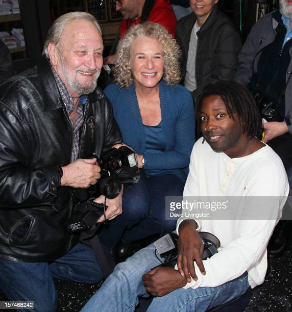 Recording artist Carole King poses with photographers at the ceremony honoring her with a Star on the Hollywood Walk of Fame on December 3 2012 in...