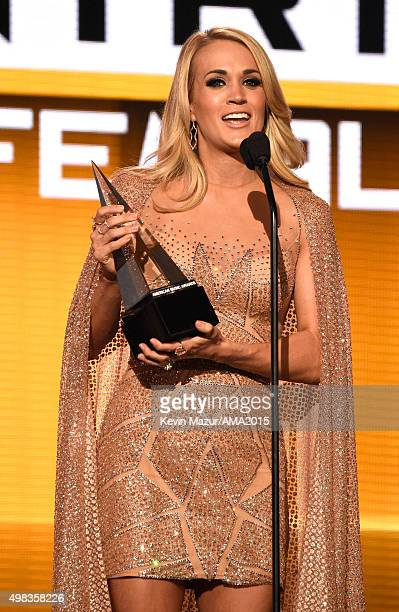 Recording artist Carrie Underwood accepts the Favorite Female Artist Country award onstage during the 2015 American Music Awards at Microsoft Theater...