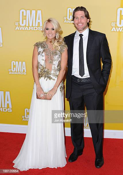 Recording Artist Carrie Underwood and her Husband NHL Player Mike Fisher attend the 46th annual CMA Awards at the Bridgestone Arena on November 1...