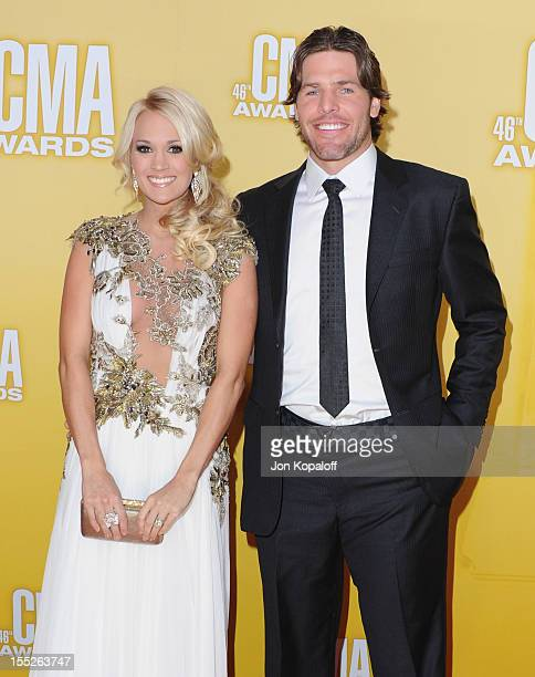 Recording artist Carrie Underwood and husband Mike Fisher attend the 46th annual CMA Awards at the Bridgestone Arena on November 1 2012 in Nashville...