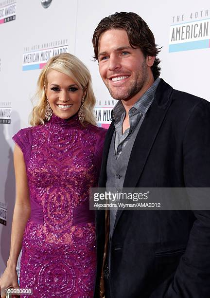 Recording artist Carrie Underwood and husband Mike Fisher attend the 40th American Music Awards held at Nokia Theatre LA Live on November 18 2012 in...