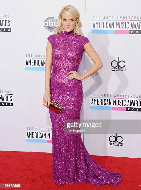 Recording artist Carrie Underwood arrives at The 40th American Music Awards at Nokia Theatre LA Live on November 18 2012 in Los Angeles California