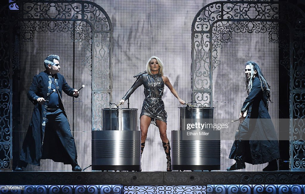 Recording artist Carrie Underwood (C) performs during the 51st Academy of Country Music Awards at MGM Grand Garden Arena on April 3, 2016 in Las Vegas, Nevada.