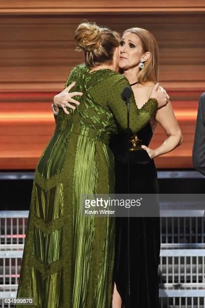 Recording artist Celine Dion presents the Song Of The Year award for 'Hello' to songwriter Adele Adkins onstage during The 59th GRAMMY Awards at...