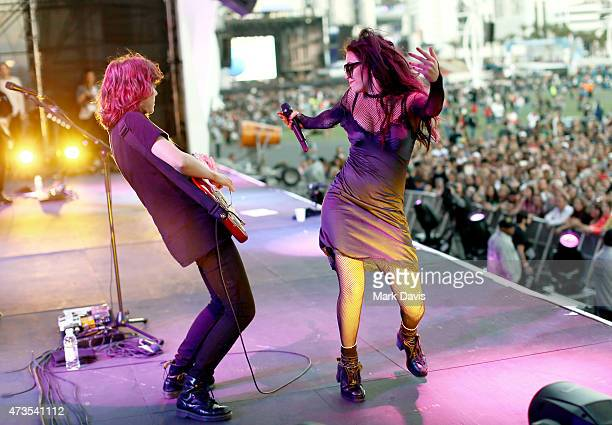 Recording artist Charli XCX and guitarist Elizabeth Caney perform onstage during Rock in Rio USA at the MGM Resorts Festival Grounds on May 15 2015...