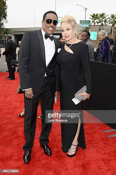 Recording artist Charlie Wilson and Mahin Tat attend the 56th GRAMMY Awards at Staples Center on January 26 2014 in Los Angeles California