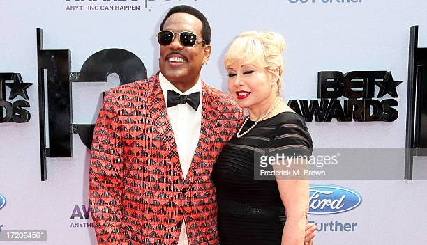 Recording artist Charlie Wilson and Mahin Wilson attend the 2013 BET Awards at Nokia Theatre LA Live on June 30 2013 in Los Angeles California