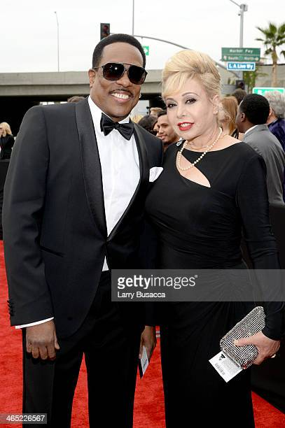 Recording artist Charlie Wilson and wife Mahin Tat attend the 56th GRAMMY Awards at Staples Center on January 26 2014 in Los Angeles California