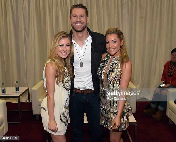 Recording artist Chase Rice poses with Madison Marlow and Taylor Dye of Maddie Tae backstage at the 2014 American Country Countdown Awards at Music...