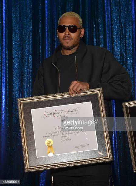 Recording artist Chris Brown accepts a BMI Special Citation of Achievement recognizing over 1 million broadcast performances of his song 'Forever' at...