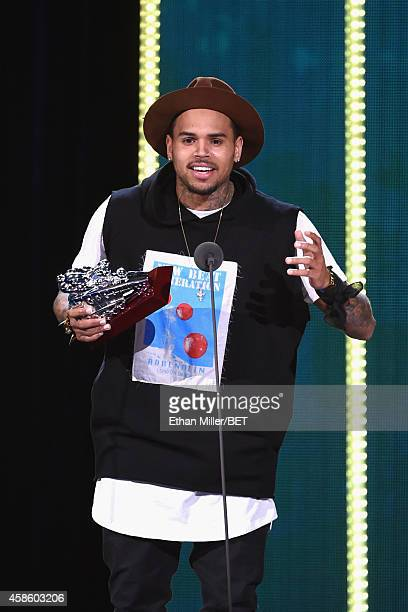 Recording artist Chris Brown accepts the Best Collaboration award for the song 'Loyal' onstage during the 2014 Soul Train Music Awards at the Orleans...