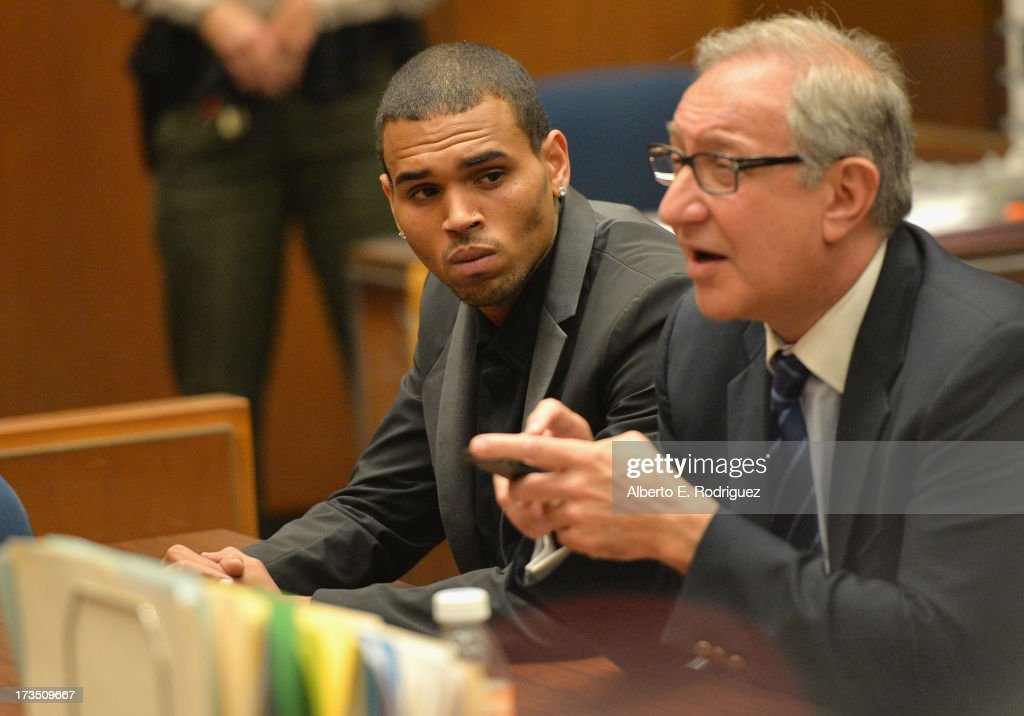 Recording artist Chris Brown and attorney Mark Geragow during Brown's court appearance on July 15, 2013 in Los Angeles, California. Brown appeared in court for a probation review hearing related to the 2009 domestic violence case in which he pleaded guilty to assaulting his then-girlfriend singer Rihanna.