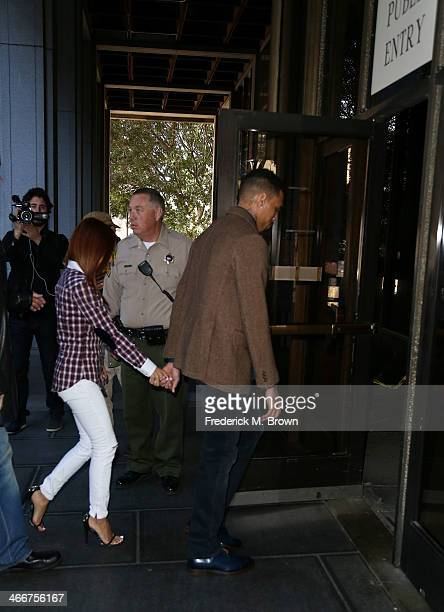 Recording artist Chris Brown and Karrueche Tran enter the Los Angeles Courthouse on February 3 2014 in Los Angeles California Brown has been on...