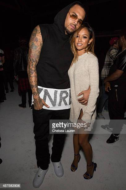 Recording artist Chris Brown and model Karrueche Tran attend Teyana Taylor's VII listening event presented by Def Jam GOOD Music and MVD Inc at Siren...