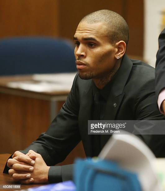 Recording artist Chris Brown appears in Los Angeles court on November 20 2013 in Los Angeles California Brown was ordered to 90 days at an inpatient...