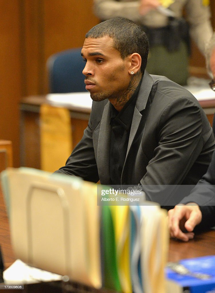 Recording artist Chris Brown during is court appearance on July 15, 2013 in Los Angeles, California. Brown appeared in court for a probation review hearing related to the 2009 domestic violence case in which he pleaded guilty to assaulting his then-girlfriend singer Rihanna.
