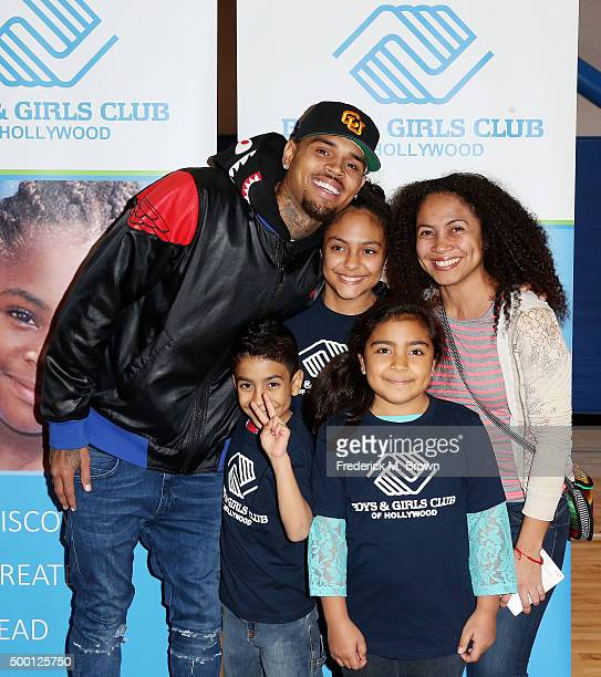 Recording artist Chris Brown presented Jessica Roncalli and her family with surprise holiday gifts and a new car at the Boys Girls Club of Hollywood...