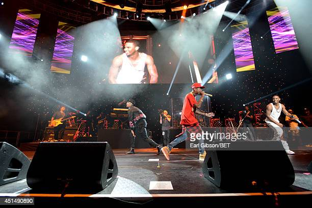 Recording artist Chris Brown rapper Tyga and singer Trey Songz perform onstage at the Mary J Blige Trey Songz And Jennifer Hudson Concert Presented...