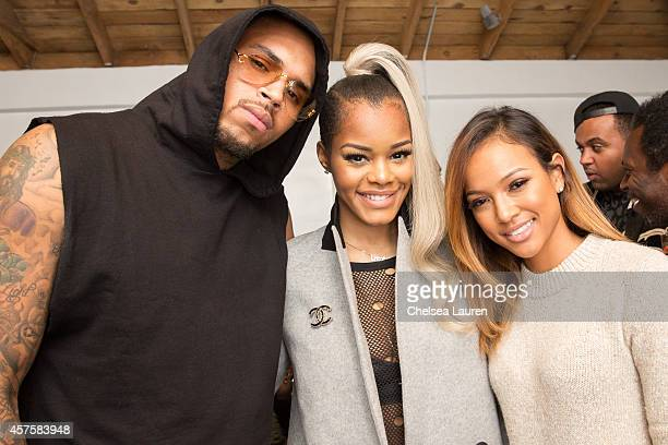 Recording artist Chris Brown recording artist Teyana Taylor and model Karrueche Tran attend Teyana Taylor's VII listening event presented by Def Jam...