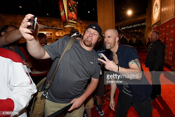 Recording artist Chris Daughtry poses for a picture with Alan Frederick of New York as Daughtry arrives on the red carpet before the 2015 NHL Awards...