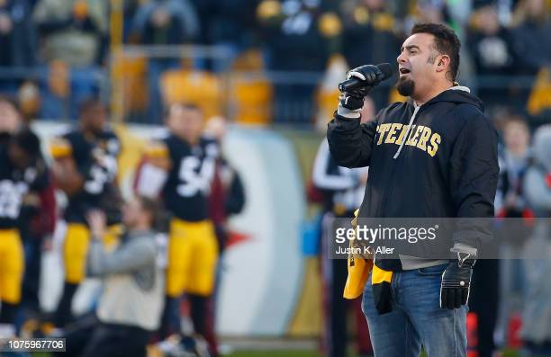 Recording artist Chris Kirkpatrick signs the National Anthem before the game between the Pittsburgh Steelers and the Cincinnati Bengals at Heinz...