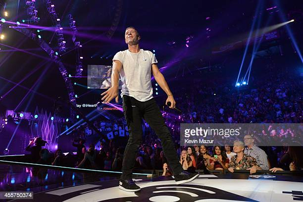 Recording artist Chris Martin from the band Coldplay performs onstage during the 2014 iHeartRadio Music Festival at the MGM Grand Garden Arena on...