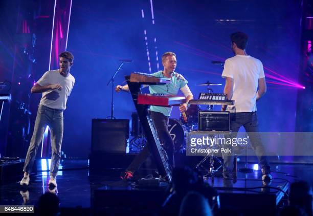 Recording artist Chris Martin performs with recording artists Andrew Taggart and Alex Pall of The Chainsmokers onstage at the 2017 iHeartRadio Music...