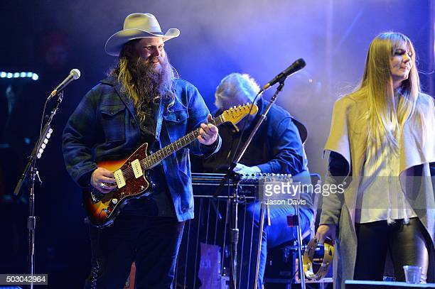 Recording Artist Chris Stapleton and wife Morgane perform on the Jack Daniel's stage during the Jack Daniel's Bash on Broadway New Year's Eve in...
