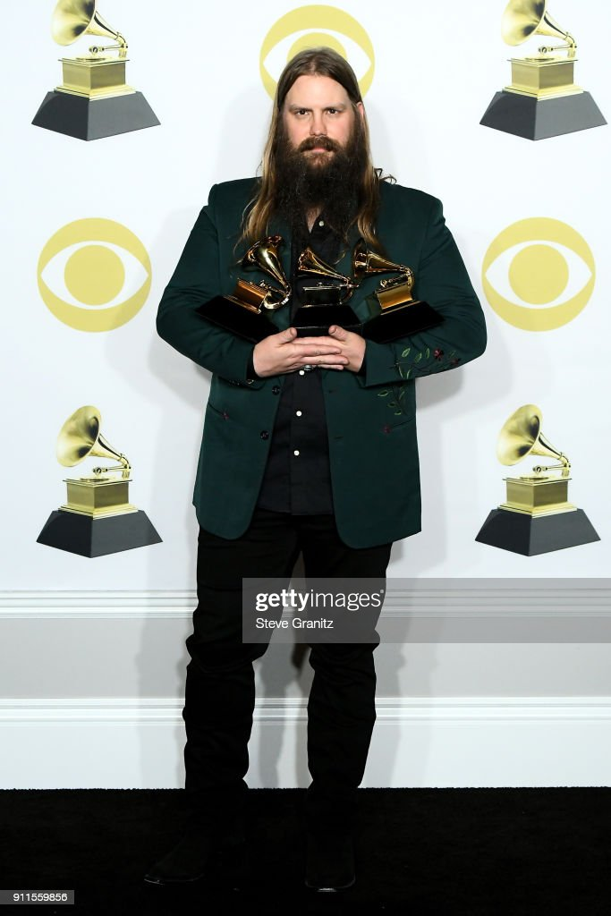 Recording artist Chris Stapleton, winner of Best Country Solo Performance, Best Country Song, and Best Country Album poses in the press room during the 60th Annual GRAMMY Awards at Madison Square Garden on January 28, 2018 in New York City.