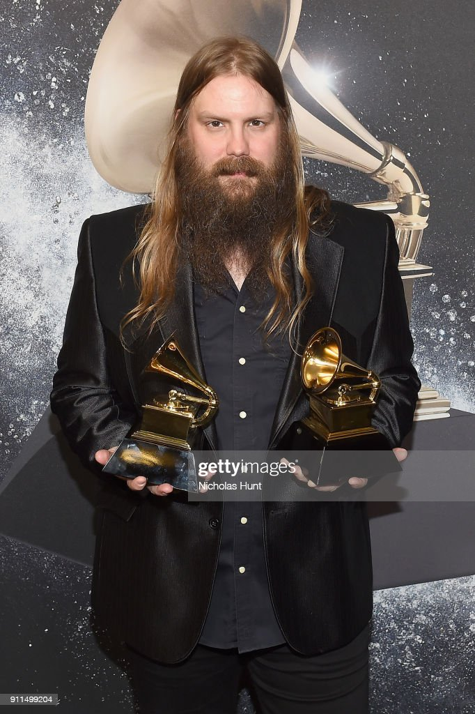 Recording artist Chris Stapleton, winner of Best Country Solo Performance for Either Way, and Best Country Song for Broken Halo, poses backstage at the Premiere Ceremony during the 60th Annual GRAMMY Awards at Madison Square Garden on January 28, 2018 in New York City.