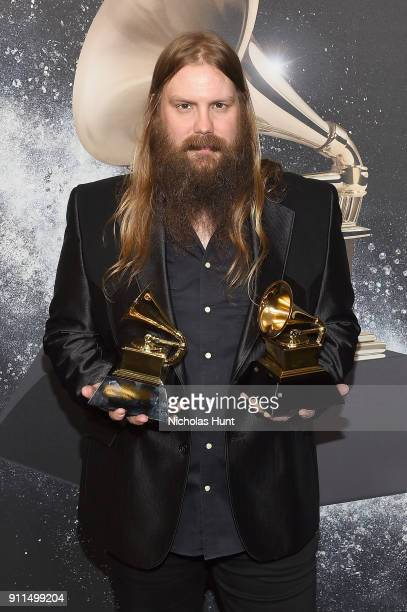 Recording artist Chris Stapleton winner of Best Country Solo Performance for Either Way and Best Country Song for Broken Halo poses backstage at the...