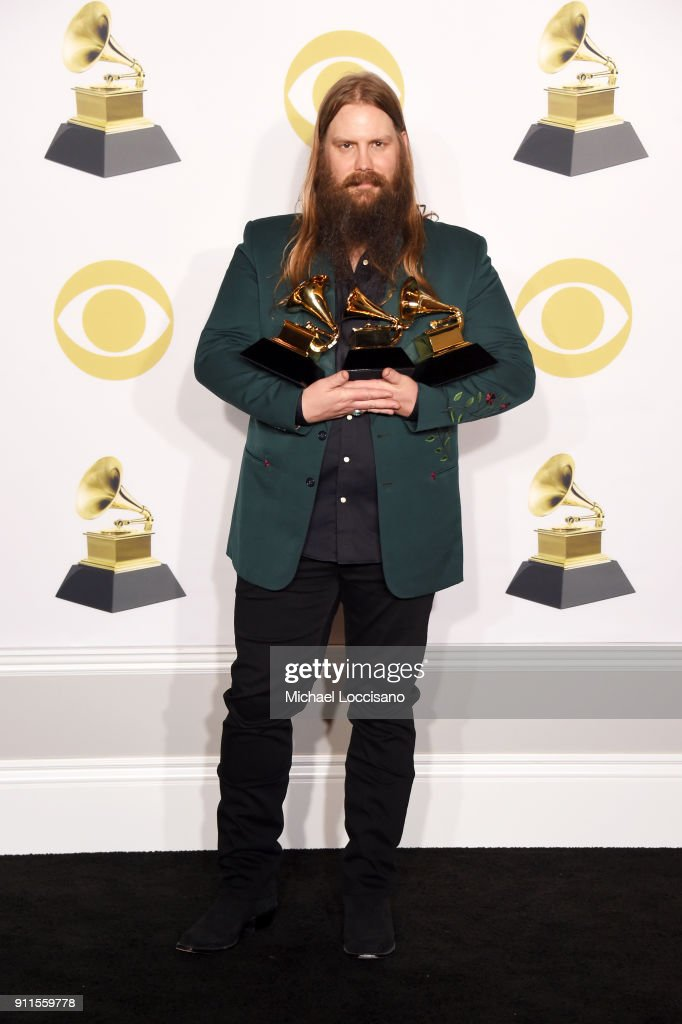 Recording artist Chris Stapleton, winner of the Best Country Album award for 'From A Room: Volume 1,' Best Country Solo Performance award for 'Either Way,' and Best Country Song for 'Broken Halos,' poses in the press room during the 60th Annual GRAMMY Awards at Madison Square Garden on January 28, 2018 in New York City.
