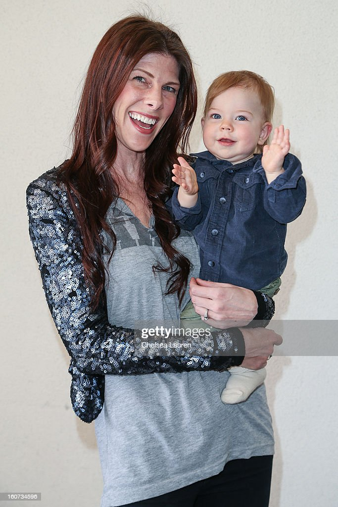 Recording artist Christa Black (L) and son Moses Grae Lionheart attend anti-human trafficking family charity luncheon in support of Unlikely Heroes at Veggie Grill on February 4, 2013 in Los Angeles, California.