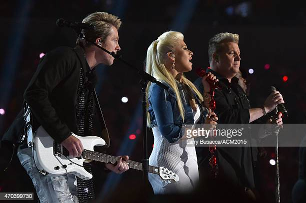 Recording artist Christina Aguilera and Rascal Flatts members Joe Don Rooney and Gary LeVox perform onstage during the 50th Academy of Country Music...