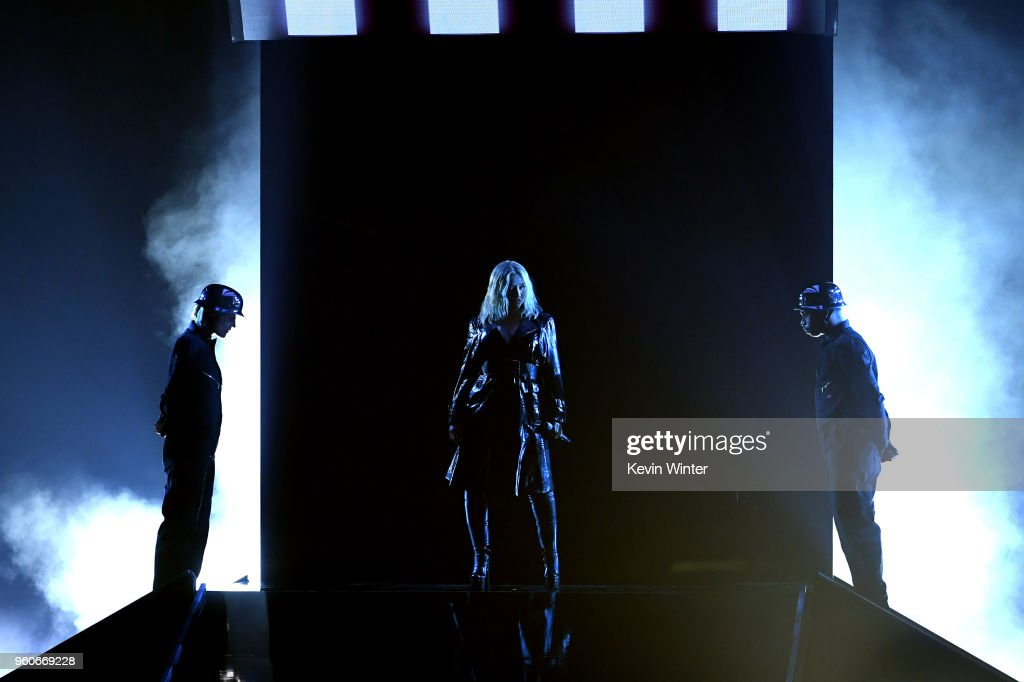 Recording artist Christina Aguilera (C) performs onstage during the 2018 Billboard Music Awards at MGM Grand Garden Arena on May 20, 2018 in Las Vegas, Nevada.
