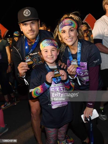 Recording artist Chuck Wicks Avery Morstad and Kasi Morstad pose with their medals after running in the Rock 'n' Roll Las Vegas 5K at the Las Vegas...