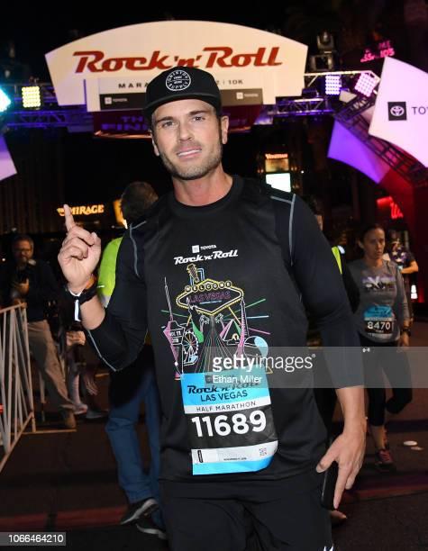 Recording artist Chuck Wicks poses after crossing the finish line of the Toyota Rock 'n' Roll Las Vegas Half Marathon on the Las Vegas Strip on...