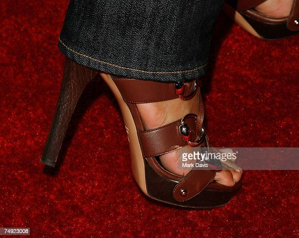 Recording artist Ciara shows her shoe to photographers at the Zomba Label Group's PreBET Awards Party featuring Ciara held at Ritual Nightclub on...