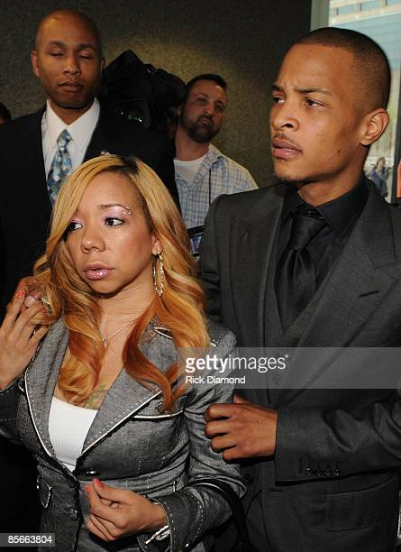 """Recording artist Clifford """"T.I."""" Harris and his fiance Tameka Cottle leave a press conference at the Richard B. Russell Federal Building and United..."""