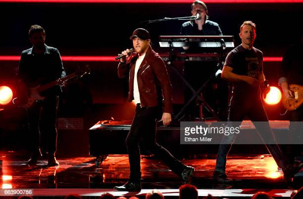 Recording artist Cole Swindell and cohost Dierks Bentley perform onstage during the 52nd Academy of Country Music Awards at TMobile Arena on April 2...