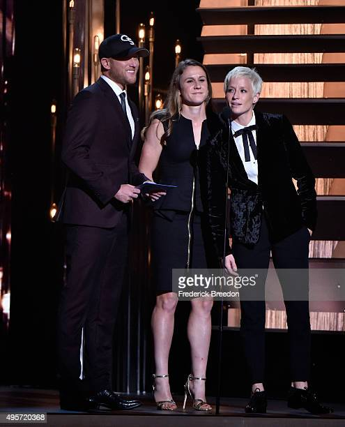 Recording artist Cole Swindell and US soccer players Heather OReilly and Megan Rapinoe speak onstage at the 49th annual CMA Awards at the Bridgestone...