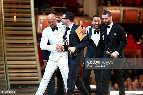 Recording artist Common songwriter Jimmy Napes recording artists John Legend and Sam Smith walk offstage the 88th Annual Academy Awards at Dolby...