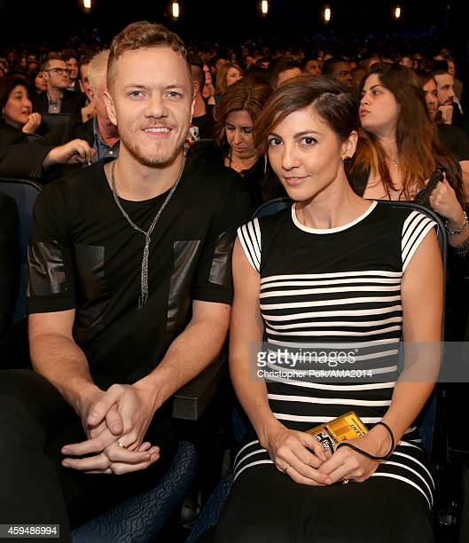 Recording artist Dan Reynolds of Imagine Dragons and Aja Volkman attend the 2014 American Music Awards at Nokia Theatre LA Live on November 23 2014...