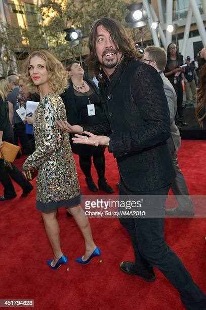 Recording artist Dave Grohl and Jordyn Blum attend the 2013 American Music Awards Powered by Dodge at Nokia Theatre LA Live on November 24 2013 in...