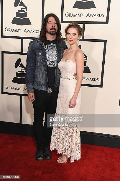 Recording artist Dave Grohl and Jordyn Blum attend The 57th Annual GRAMMY Awards at the STAPLES Center on February 8 2015 in Los Angeles California