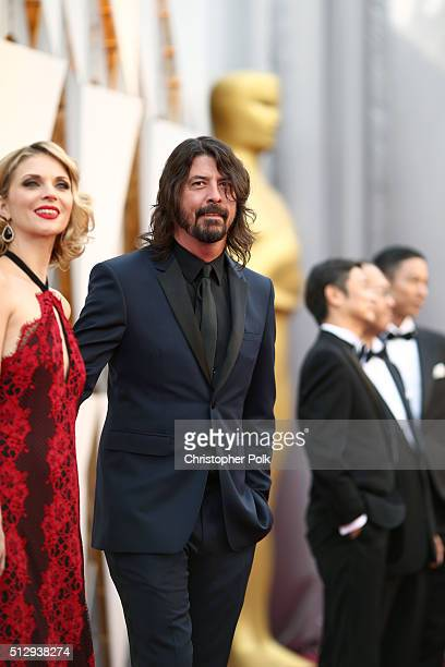 Recording artist Dave Grohl and Jordyn Blum attend the 88th Annual Academy Awards at Hollywood Highland Center on February 28 2016 in Hollywood...