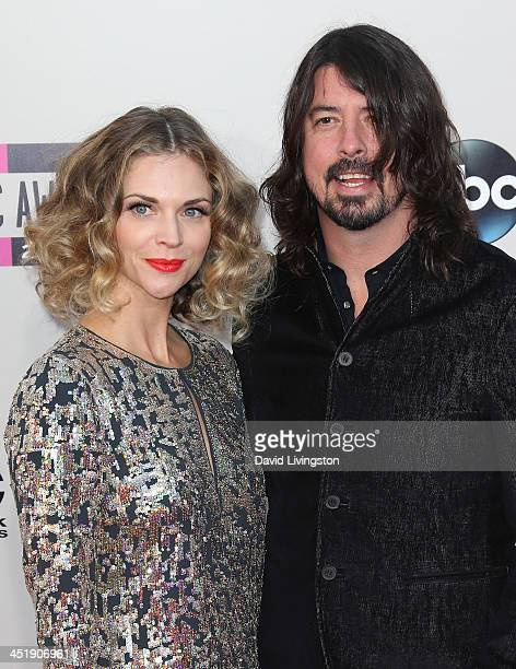 Recording artist Dave Grohl and wife Jordyn Blum attend the 2013 American Music Awards at Nokia Theatre LA Live on November 24 2013 in Los Angeles...