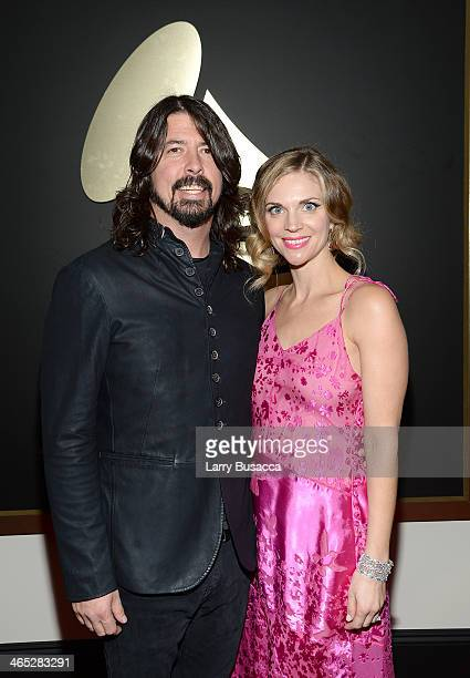 Recording artist Dave Grohl and wife Jordyn Blum attend the 56th GRAMMY Awards at Staples Center on January 26 2014 in Los Angeles California