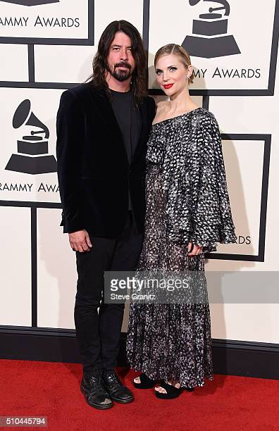 Recording artist Dave Grohl of Foo Fighters and Jordyn Blum attend The 58th GRAMMY Awards at Staples Center on February 15 2016 in Los Angeles...
