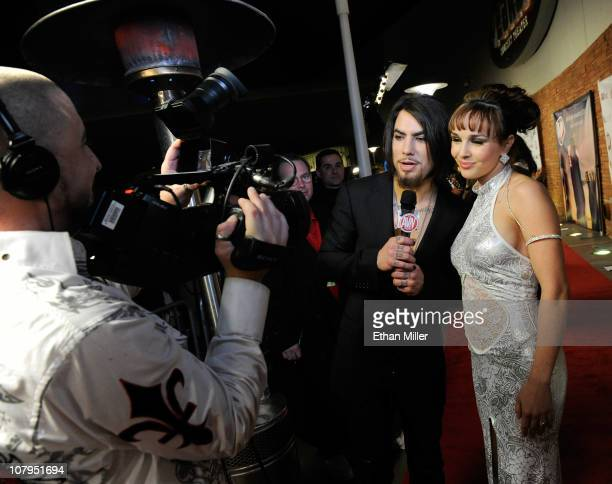 Recording artist Dave Navarro interviews adult film actress Cytherea as she arrives at the 28th annual Adult Video News Awards Show at the Palms...